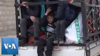 Syrians Flee Aleppo After Airstrikes Kill 2 Children