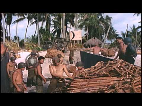 A bulldozer hauls material from a LSM in Makin Islands, Kirabati during World War...HD Stock Footage