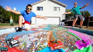 GIANT RC MAGIC TRACKS VS ORBEEZ POOL ADVENTURE!