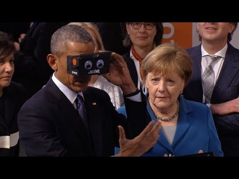Obama, Merkel try 'virtual reality' glasses