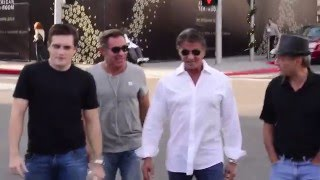 Sylvester Stallone checks out the Stallone Auctions catalog with his posse in Beverly Hills, Ca