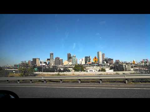 Driving past downtown Denver and Mile High Stadium