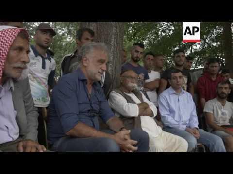 Activists, lawyer, visit Yazidi camp in Greece