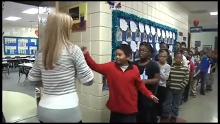 Amazing Female teacher doing the batch of handshakes with  a 3…