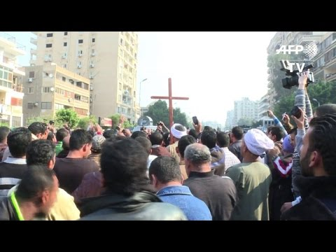 Egyptian Copts gather to mourn victims of bomb blast