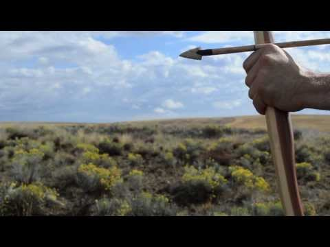 Making a Primitive Yew Bow for primitive archery hunting using stone tools. Otzi the Iceman bow.