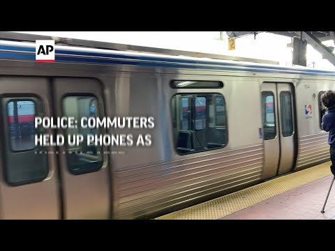 Police: commuters held up phones as woman raped