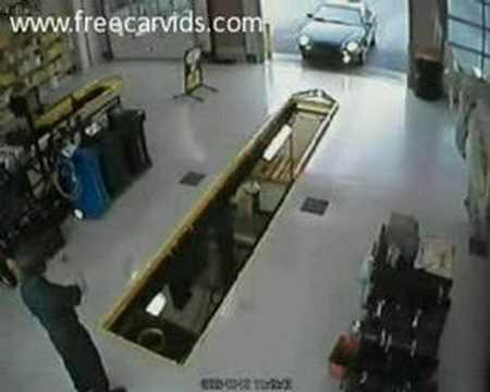 Bad Driver Drives Car Into Mechanics Pit Youtube