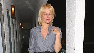 PREMIUM EXCLUSIVE: Pamela Anderson And Mystery Man Arrive At Cheap Motel After Partying