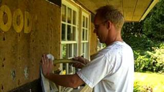 Dense pack cellulose insulation from exterior redwood siding