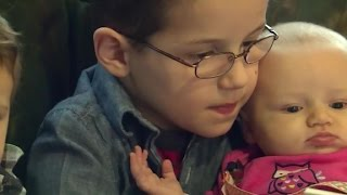 Boy donates his gaming system to police