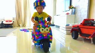 Senya Assembling a Bike from Colored Blocks.