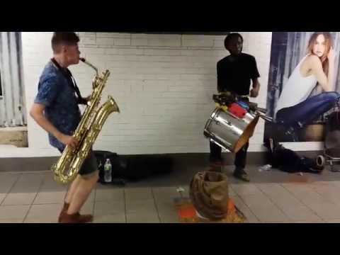 TOO MANY ZOOZ Baritone Saxophone and Drummer Duo Street Perf