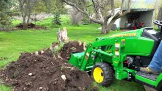 Apple tree stump removal with new john deere 1025r tlb
