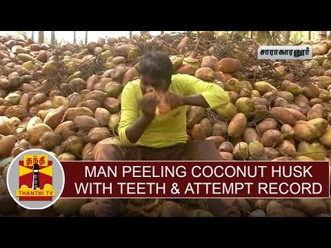 Man peeling coconut husk with teeth & attempt to enter the Limca book of records