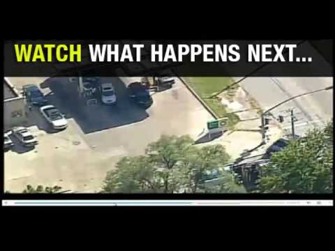 Kansas City cop fires on fleeing vehicle as news copter records it from above