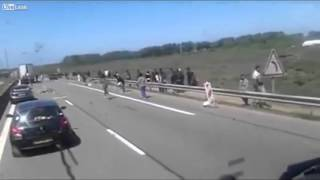 Truck driver filmed aggressive migrant mob on the highway near Austria
