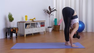 Flexible Indian girl doing Eka Pada Rajakapotasana (one-legged king pigeon pose) - Yoga for health