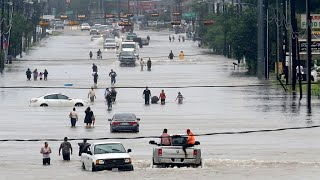 Tropical Storm Harvey's deluge drives people to rooftops in Houston