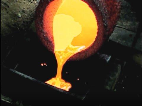 Pouring Molten Copper Into A 200 OZ Bar Mold Ingot