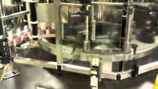 Quadrel | Labeling Systems | Rotary Labeling | High Speed Glass Bottle Labeling