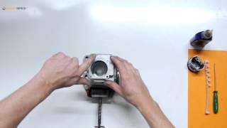 Montage d'un piston à l'aide d'une bande de serrage sur une tronçonneuse Stihl