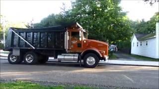 Dump trucks line up for street paving