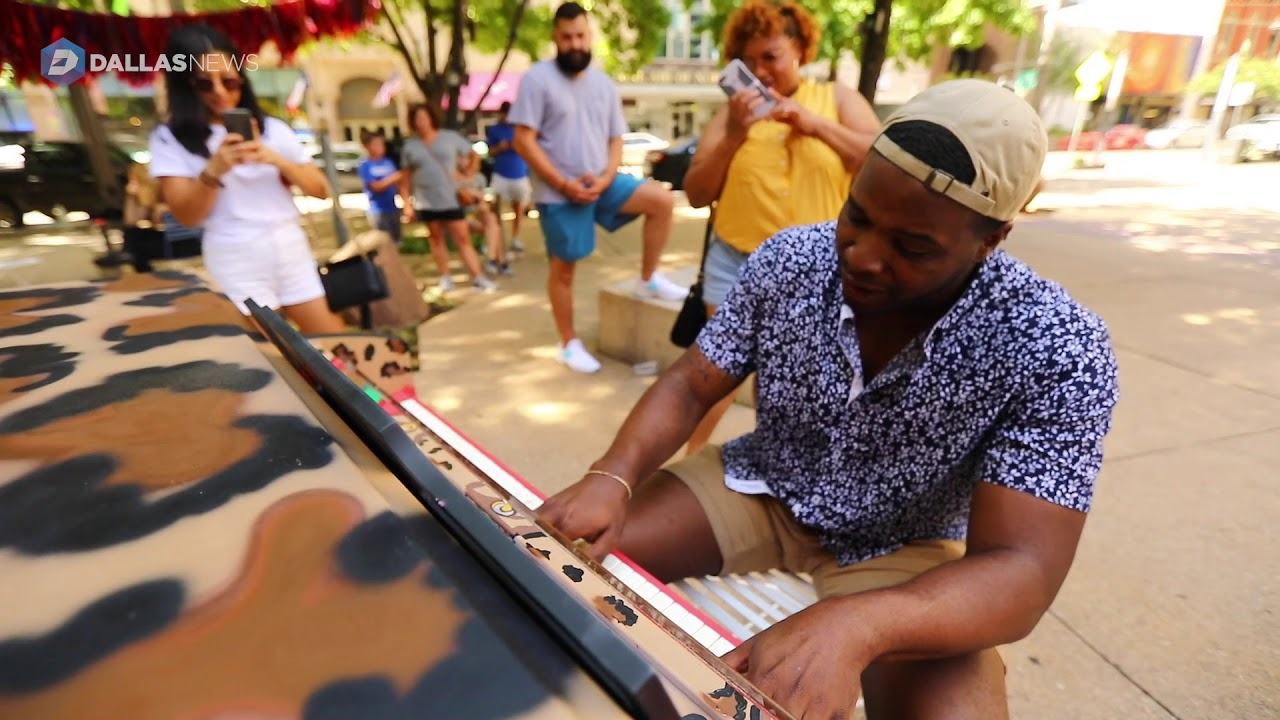 painted-piano-invites-people-to-sit-and-play-in-pegasus-plaza