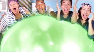 popping the world s biggest wubble bubble glow in the dark