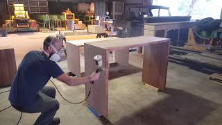 Wood finishing - Spraying lacquer on sapele desks