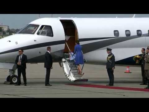 Princess Charlotte needs a hand to board the royal jet