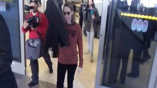 Jodie Foster Avoids The Paparazzi With Her Coat At LAX