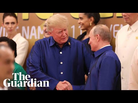 Donald Trump and Vladimir Putin shake hands at Apec