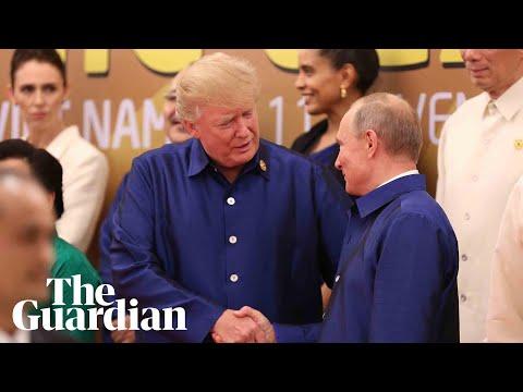 Donald Trump and Vladimir Putin shake hands at Apec