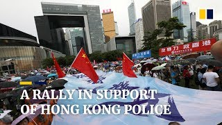 Tens of thousands brave the rain to show support for Hong Kong police