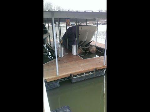 Raising a half sunk boat, boat lift fail