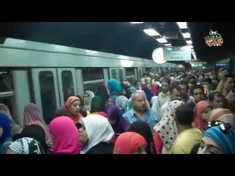 Metro commuters react to its impairment between two stations in Cairo