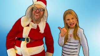 Amelia gets a surprise visit by Santa Claus. Fun Christmas adventure decorating the Christmas tree!