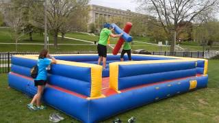 Students at U of I battle on our Gladiator Jousting inflatable game