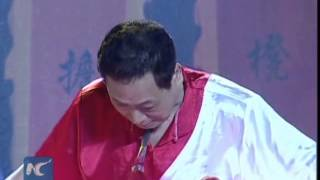 Dramatic Kung Fu: Man breaks brick with spear on neck