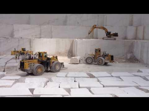 Komatsu WA800,WA600,Cat 992B Loaders, And Cat345B Working At Marble Quarry