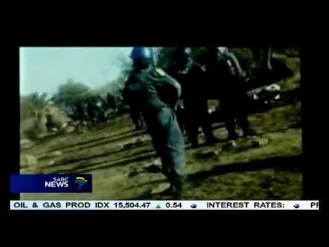 Video shows police sergeant shooting striking miner : Marikana
