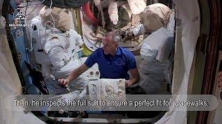 David Saint-Jacques and his spacesuit