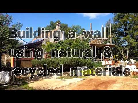 Making a wall from recycled and natural Materials. Croatia