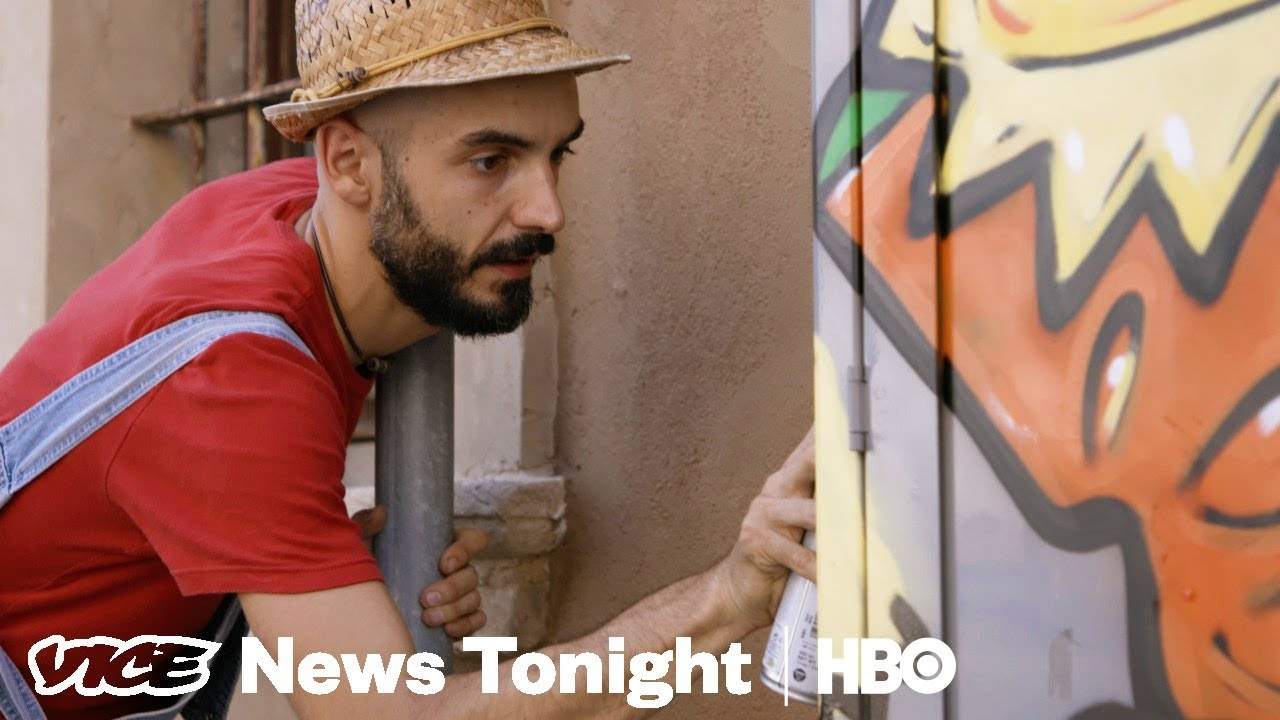 9a7d8bc5 The Italian Street Artist Using Cheese Paintings To Fight Neo-Fascism  (HBO). VICE News