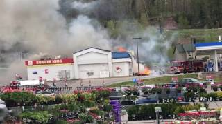 Firefighter Trapped as Burning Gas Station Facade Collapses in Michigan