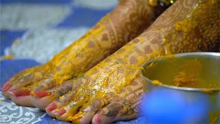 Closeup shot of Indian brides feet with mehndi and Haldi - pre-wedding ceremonies in India