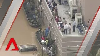 Floods and landslides from record rainfall in Western Japan have le...