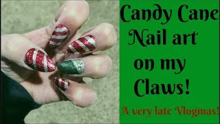 Candy Cane Nail art Inspired by Simply Nailogical. Sorry for the lateness.