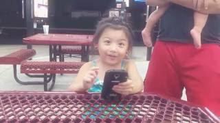 Toddler catching Weedle on Pokémon Go